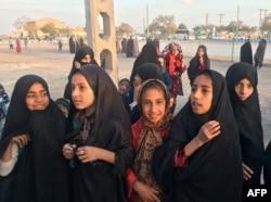 FILE - Afghan refugee girls gather at the Bardsir settlement for Afghan refugees in Kerman province, Iran, Oct. 22, 2016.