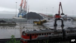 FILE - Coal brought from Siberia can be seen awaiting loading onto a ship bound for China in the North Korean special economic zone of Rason. The Liaoning Hongxiang Group allegedly sold North Korea aluminum bars and chemicals that have potential military purposes.