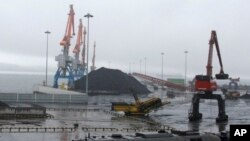 Coal brought from Siberia is ready to be loaded onto a ship bound for China in the North Korean special economic zone of Rason.