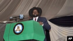 FILE - South Sudan President Salva Kiir voices his reservations before signing a peace deal in the capital Juba, South Sudan, Aug. 26, 2015.