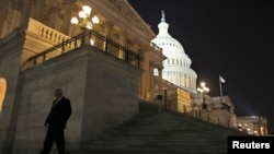 A member of the U.S. House of Representatives walks down the steps of the U.S. Capitol in Washington at nightfall September 30, 2013.