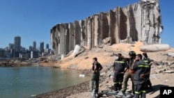 A rescue team surveys the site of this week's massive explosion in the port of Beirut, Lebanon, Aug. 7, 2020.