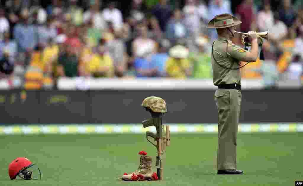 A bugler from the Australian Army plays to commemorate the 100th anniversary of the 1915 ANZAC landing at Gallipoli prior to the day one game of the first Test cricket match between Australia and New Zealand in Brisbane.