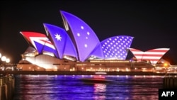 The flags of the US and Australia are projected onto the sails of the Opera House to commemorate the 70th anniversary of the alliance between Australia, New Zealand and the US known as the ANZUS Treaty in Sydney on Sept. 1, 2021.