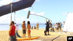 """Hawaii Five-0"" stars Scott Caan and Grace Park film on location on the beach."