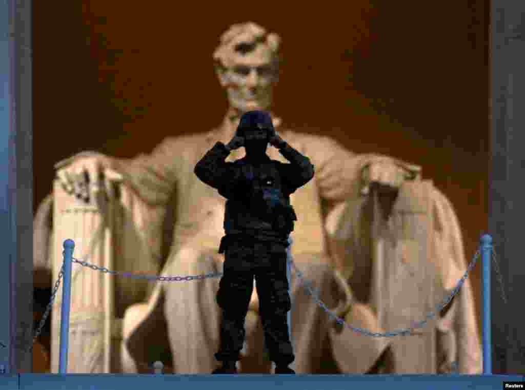 At sunrise, a soldier keeps watch at the Lincoln Memorial in Washington after a night of protests over the death in Minneapolis police custody of George Floyd.