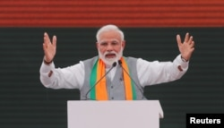 FILE - Indian Prime Minister Narendra Modi gestures as he speaks in New Delhi, April 8, 2019.