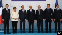 European Union leaders stand for a minute of silence to honor the victims of the attacks in Paris. The leaders are struggling with the complex issue of the migration crisis and also security.