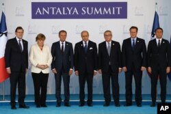European Union leaders stand in a minute of silence to honour the victims of the attacks in Paris, at the G-20 Summit in Antalya, Turkey, Nov. 16, 2015.