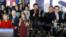 在爱奥华州党团会议选举中初战告捷的希拉里·克林顿和泰德·克鲁兹。 (2016年2月1日)