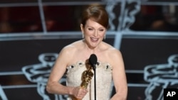 "Julianne Moore accepts the award for best actress in a leading role for ""Still Alice at the Oscars on Sunday, Feb. 22, 2015, at the Dolby Theatre in Los Angeles. (Photo by John Shearer/Invision/AP)"