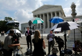 Numerous news crews wait outside the Supreme Court, which is expected to rule on several key cases yet this term, in Washington, June 25, 2014.