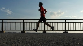 A man jogs at Labrador Park in Singapore in this August 29, 2013, file photo.