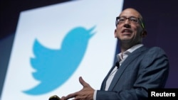 FILE - Twitter CEO Dick Costolo gestures during a conference at the Cannes Lions in Cannes, France, June 20, 2012.