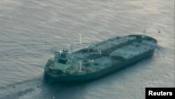 A still image from video taken by a U.S. Coast Guard HC-144 Ocean Sentry aircraft shows the oil tanker Union Kalavryta, which is carrying a cargo of Kurdish crude oil, approaching Galveston, Texas, July 25, 2014.