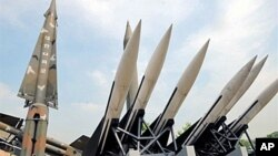 A visitor takes pictures of replicas of North Korea's Scud-B missile, (center green) and South Korean missiles that are displayed at the Korean War Memorial in Seoul. North Korea said it would bolster its nuclear weaponry with an unspecified new method in