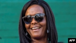 (FILE) This file photo taken on August 25, 2017 shows Zimbabwe's first lady Grace Mugabe attending the opening of the annual agricultural fair in the capital Harare. Zimbabwe's leading university has published the thesis submitted by former first lady Grace Mugabe, who was controversially awarded a doctorate which is now the subject of a fraud investigation. AFP PHOTO / Jekesai NJIKIZANA