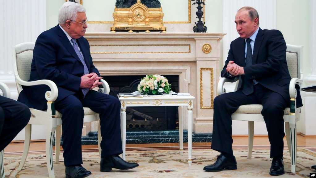 Russian President Vladimir Putin, right, speaks to Palestinian President Mahmoud Abbas, during their meeting in the Kremlin in Moscow, Feb. 12, 2018.