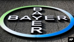 FILE - Germany-based Bayer AG has a deal to acquire U.S.-based Monsanto Co. A U.S. Senate panel on Tuesday is scrutinizing the proposed merger.