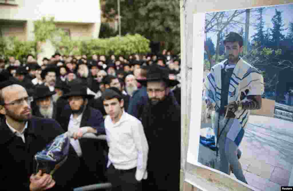 A photograph of Yoav Hattab, killed in an attack on a Paris grocery on Friday, is displayed during a procession before his funeral in Bnei Brak near Tel Aviv, Jan. 13, 2015.