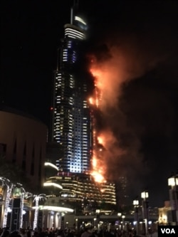 The luxury Address Downtown Dubai hotel, a favorite with international celebrities and wealthy travelers, had been packed with people who came to see the fireworks. Authorities said they were able to evacuate everyone safely. (M. Besheer/VOA)