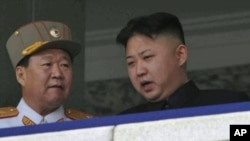 FILE - North Korean leader Kim Jong Un, right, speaks with Vice Marshal Choe Ryong Hae during a mass military parade in Kim Il Sung Square in Pyongyang, North Korea, April 15, 2012.