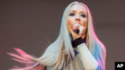 Amethyst Amelia Kelly, also known as Iggy Azalea, performs during Music Midtown 2014 at Piedmont Park in Atlanta, Sept. 19, 2014.