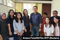 """Former Jakarta Gov. Basuki """"Ahok"""" Tjahaja Purnama poses with his relatives after being released from prison in Jakarta, Indonesia, Jan. 24, 2019."""