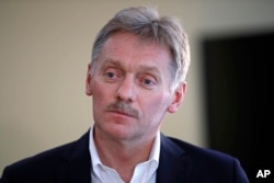 President Vladimir Putin's spokesman Dmitry Peskov speaks with The Associated Press in Moscow, April 6, 2017. Peskov, speaking days after a suspected chemical weapons attack, says Russia's support for Syrian President Bashar Assad is not unconditional.