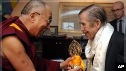 FILE - in this Dec. 10 2011 file photo Tibetan spiritual leader the Dalai Lama, left, hands a present to Czech ex-president Vaclav Havel, right, during their meeting in Prague, Saturday, Dec. 10, 2011. Havel, the dissident playwright who wove theater into