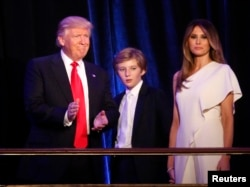Republican U.S. president-elect Donald Trump stands with his son Barron and wife Melania at his election night rally in Manhattan, New York, Nov. 9, 2016.