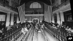 This is a 1924 photo of the immigration registry room at Ellis Island in New York Harbor.