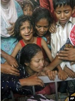 被巴基斯坦安全部隊擊斃的死者家屬
