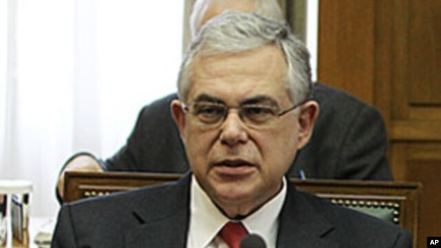 Greek Prime Minister Lucas Papademos attends a cabinet meeting at the Greek Parliament in Athens, March 9, 2012.