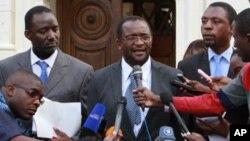 MDC spokesperson Douglas Mwonzora, centre, addresses the media outside the Constitutional Court in Harare.