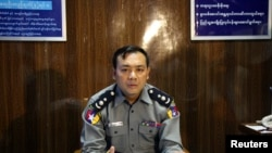 Chief Superintendent Zaw Min Oo talks to the media during a news conference about riots in Mandalay, July 2, 2014.