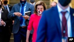 House Speaker Nancy Pelosi of California arrives for a House Democratic caucus meeting on Capitol Hill in Washington, Sept. 28, 2021.
