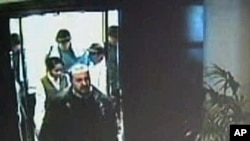 A hotel security camera shows men in tennis outfits following Hamas commander Mahmoud al-Mabhouh into his hotel room