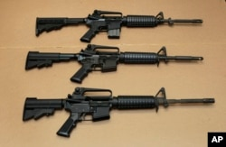 FILE -- Three variations of the AR-15 assault rifle are displayed in Sacramento, Calif.