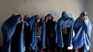 Male Afghan women's rights activist wear burqas to show their solidarity with Afghan women ahead of International Women's Day in Kabul.