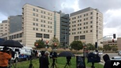 A large gathering of media personnel camp outside the Ronald Reagan UCLA Medical Center in Los Angeles, Dec. 23, 2016, where TMZ and the Los Angeles Times reported actress Carrie Fisher had been taken after suffering a medical emergency on a flight from London to Los Angeles.