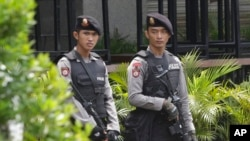 FILE - Armed police stand outside the Starbucks cafe where an attack occurred on Thursday, in Jakarta, Indonesia, Jan. 15, 2016.