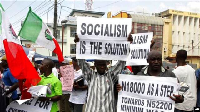 Trade union members display placards during a protest, in Lagos, Nigeria, Nov 10, 2010