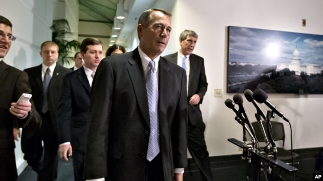 Speaker of the House John Boehner talks to reporters in Washington, Monday, Dec. 31, 2012.