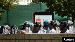 Police guard the entrance of Albania's Central Election Commission during a protest, Tirana, May 21, 2011.