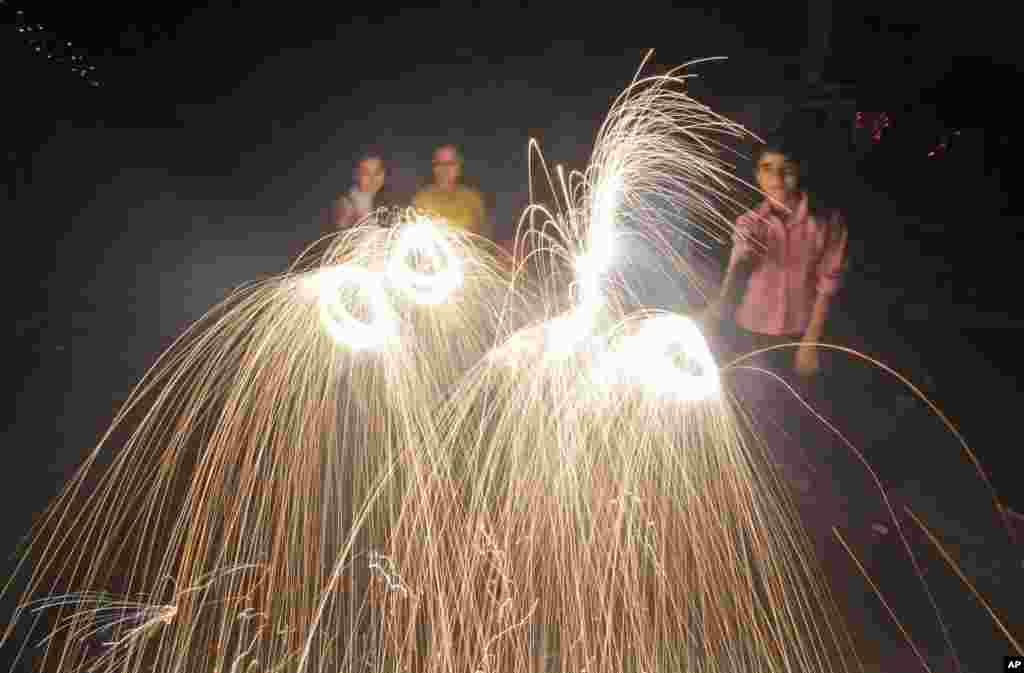 People set off fireworks to celebrate Diwali, Jammu, India, Nov. 3, 2013.
