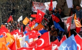 Supporters of the ruling AK Party wave Turkish and party flags during an election rally in Konya, central Turkey, Mar. 28, 2014.