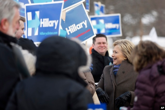 Democratic presidential candidate Hillary Clinton campaigns outside a polling place during the first-in-the-nation presidential primary, in Nashua, N.H., Feb. 9, 2016.