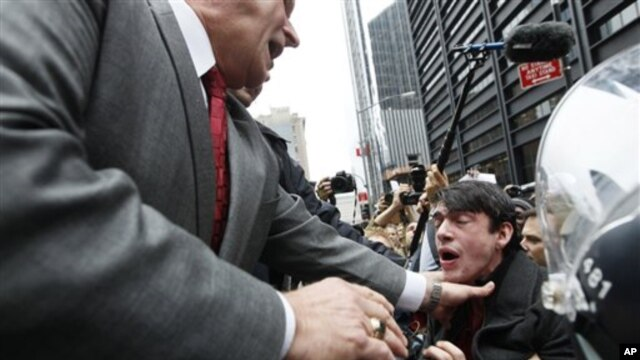 A New York City policeman keeps a demonstrator affiliated with the Occupy Wall Street movement from entering  Zuccotti Park Tuesday, Nov. 15, 2011