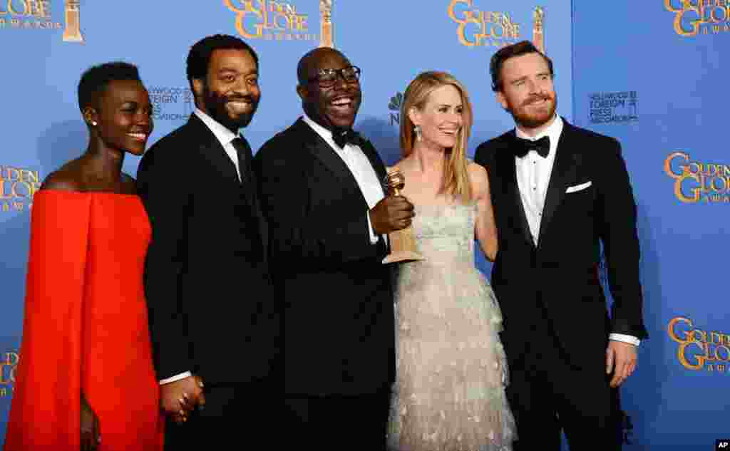 Lupita Nyong'o, Chiwetel Ejiofor, Steve McQueen, Sarah Paulson, and Michael Fassbender pose with the award for best motion picture - drama for '12 Years a Slave' at the Golden Globe Awards, Jan. 12, 2013.